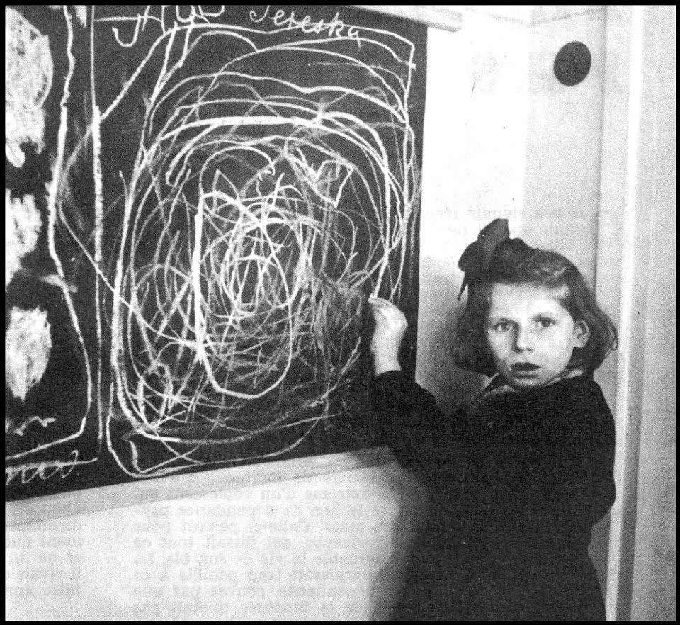 A girl who grew up in a concentration camp draws a picture of Home while living in a residence for disturbed children. Poland, 1948.