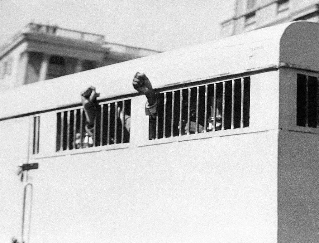 Nelson Mandela keeps his fists raised after he was sentenced to life imprisonment, June 1964