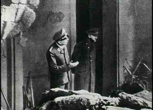 The last photo taken of Adolf Hitler as he overlooks the damage in Berlin,1945