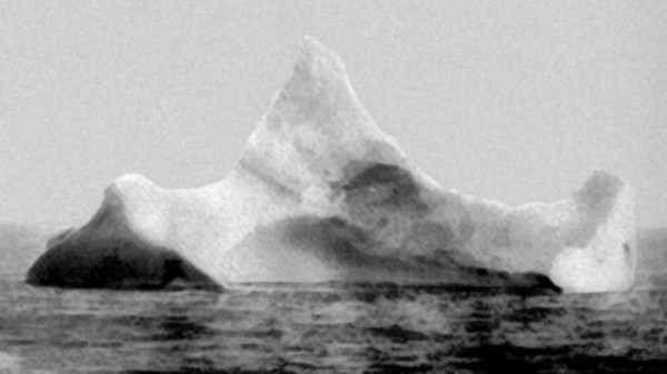1912, Iceberg that had red and black paint on it. They believe that this is the iceberg that sank the Titanic. photographed in 1912.
