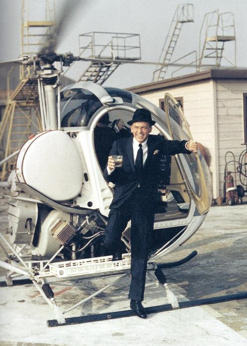 1964_Frank Sinatra stepping off of a helicopter with a drink in his hand, by Yul Brynner