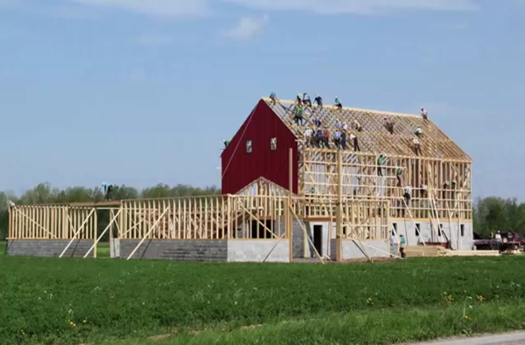 Religion earthly mission for Amish barn construction