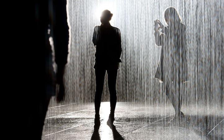 Visitors walk through an art installatio