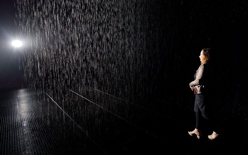 A woman walks through an art installatio