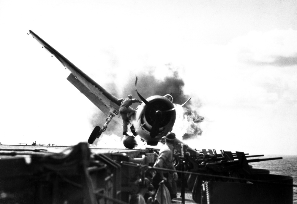 Crash landing of Grumman F6F Hellcat on flight deck of USS Enterprise, November 1943