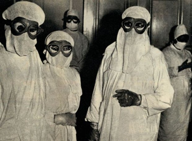 Doctors in protective clothing during an outbreak of smallpox in Wroclaw, Poland; July 20, 1963