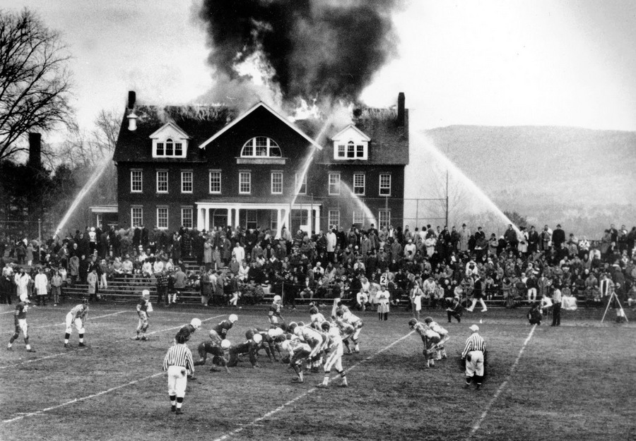 The game goes on in spite of the November, 1965 fire at Silliman Hall on the campus of Northfield Mount Hermon School in Massachusetts. The building burned down to the ground and the game was lost too.