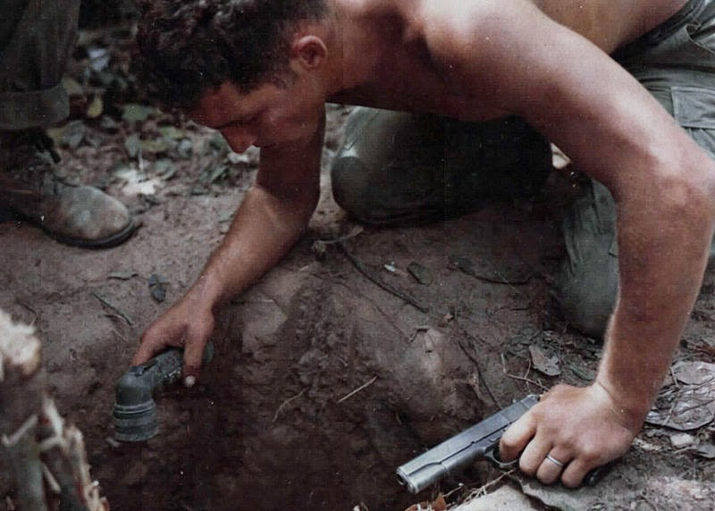 1969 US Marine prepares to enter a Vietcong tunnel