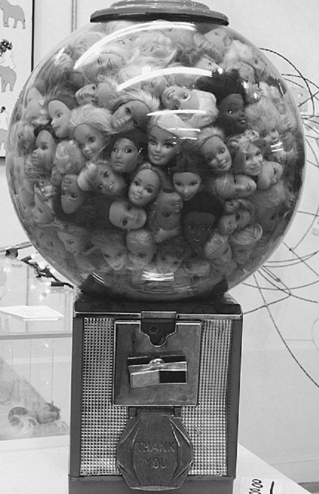 weird design barbie gum machine